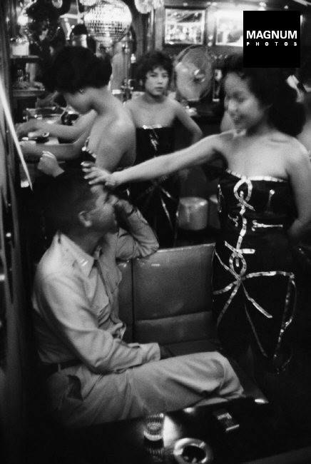 JAPAN, 1958. The Albion cabaret in Tokyo. This was one of the most popular places for F.I.S. Waitresses, all in sexy dresses or shorts, greet customers with shout of welcome. Current american musical favourites fill the air.